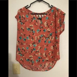 Coral shirt with floral print